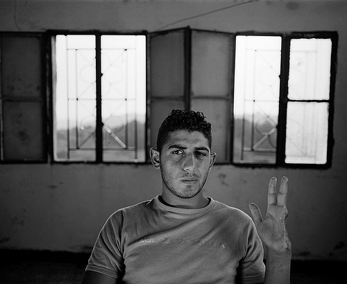 Mohammed Mahdi shows his hand severed by a cluster bomb. Photograph provided by UNMAS.